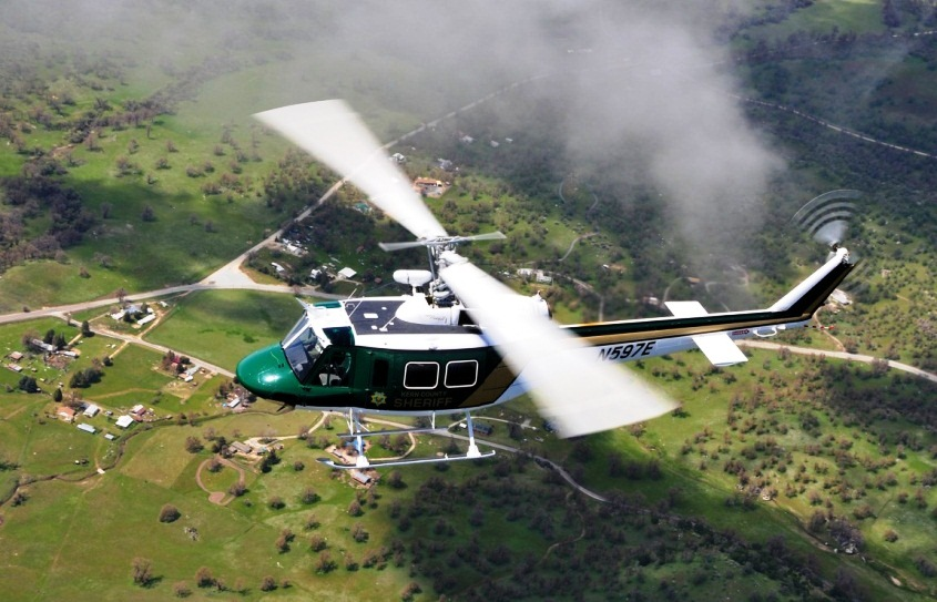 Kern County Sheriff's Helicopter Flying over rural area